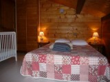 la clusaz holiday demima chalet double bedroom with baby cot